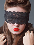 Portrait of a charming woman in black lace mask. Stock Image