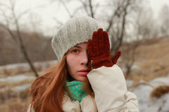 Portrait of a charming woman covering face with palm. stock photo