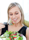 Portrait of a charming woman eating a salad Royalty Free Stock Image