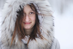 Portrait of charming woman in fur lined hoodie Stock Images