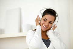 Charming woman with headphone listening music. Portrait of a charming woman with headphone listening music Royalty Free Stock Photography