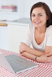 Portrait of a charming woman with a laptop Royalty Free Stock Photo