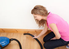 Portrait of a charming woman vacuuming Royalty Free Stock Photography