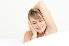Portrait of a charming woman waking up Royalty Free Stock Image