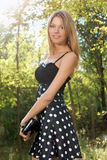 Portrait of a charming young blonde. In the forest Royalty Free Stock Photos