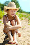 Portrait of charming young girl sitting on log Stock Photo
