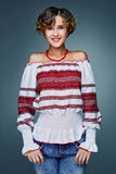 Portrait charming young lady with short wavy hair in embroidery. Stock Photos