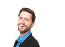 Portrait of a charming young man with beard laughing. Close up portrait of a charming young man with beard laughing on isolated white background Stock Photo