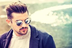 Portrait of charming young man with sunglasses outdoors Royalty Free Stock Images
