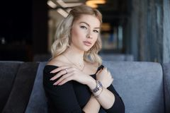 Portrait charming young woman with friendly smile, long blonde hair smiling royalty free stock photo
