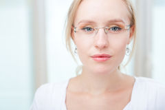 Portrait of a charming young  woman with glasses Stock Images