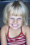 Portrait of cheeky girl. Portrait of a toddler, trying to look angry Royalty Free Stock Photos