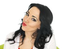 Portrait of a Cheeky Young Hispanic Woman Pulling Silly Faces Royalty Free Stock Photography