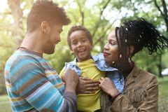 Portrait of cheerful African American parents with daughter in royalty free stock photos