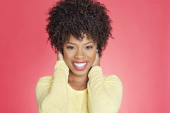 Portrait of a cheerful African American woman with hands over ears Royalty Free Stock Photos