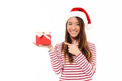 Portrait of a cheerful asian girl in christmas hat stock image