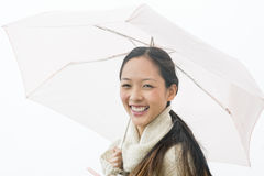 Portrait Of Cheerful Asian Woman Holding Umbrella Stock Images