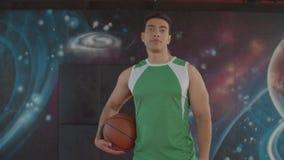 Smiling black basketball player holding ball