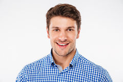 Portrait of cheerful attractive young man in checkered shirt Stock Image