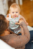 Portrait of cheerful baby playing on mamas knees Stock Photography