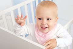 Portrait of a cheerful baby waving hello Royalty Free Stock Photos