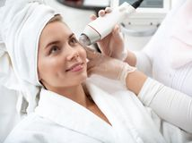 Satisfied lady during cosmetic procedure stock images