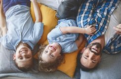 Outgoing dad resting with happy children stock images