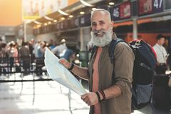 Happy retire looking at map Royalty Free Stock Photography