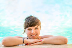 Portrait of a cheerful and beautiful girl in the pool Royalty Free Stock Images