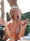 Portrait of a cheerful blond girl in the mud Stock Photos