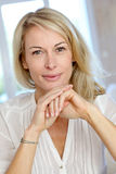 Portrait of cheerful blond woman smiling Stock Photo
