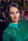 Portrait of cheerful blondie girl near decorated Christmas tree Royalty Free Stock Image