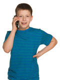 Cheerful boy with a cell phone Royalty Free Stock Image