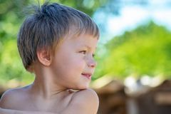 Portrait of cheerful boy outdoors on summer vacation stock photo