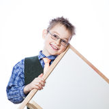 Portrait of cheerful boy pointing to banner Royalty Free Stock Image