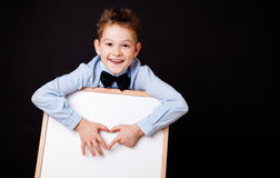 Portrait of cheerful boy pointing on white banner Royalty Free Stock Photo