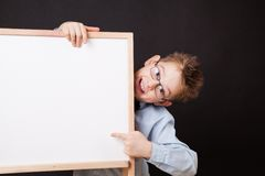 Portrait of cheerful boy pointing on white banner stock image