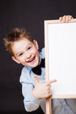 Portrait of cheerful boy pointing on white banner stock photography