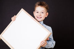 Portrait of cheerful boy pointing on white banner stock images