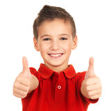 Portrait of cheerful boy showing thumbs up gesture. Isolated over white background Royalty Free Stock Images