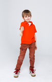 Portrait of cheerful boy showing thumbs up gesture. Full length portrait of cheerful boy showing thumb up gesture over white studio background. Happy smiling boy Royalty Free Stock Photography