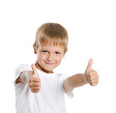Portrait of cheerful boy showing thumbs up gesture. Over white background Royalty Free Stock Photography