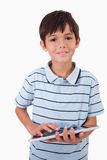 Portrait of a cheerful boy using a tablet computer Stock Image