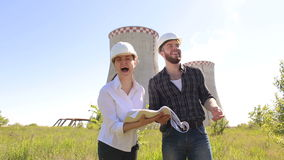 Portrait of cheerful builders in helmets outdoors. stock video