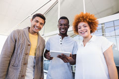 Portrait of cheerful business people with digital tablet Stock Photography