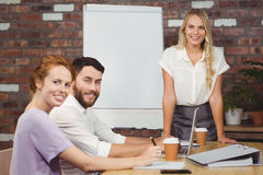 Portrait of cheerful business people during presentation Stock Photography