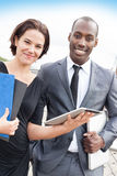 Portrait of cheerful business people working Stock Photo