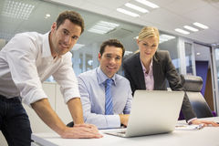 Portrait of cheerful business team in office, looking camera Stock Photos