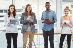 Portrait of cheerful business team using technology Stock Photos