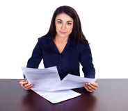 Portrait of a cheerful business woman sitting on her desk and sign up contract on white background Royalty Free Stock Photo